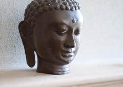 Buddha auf dem Kamin